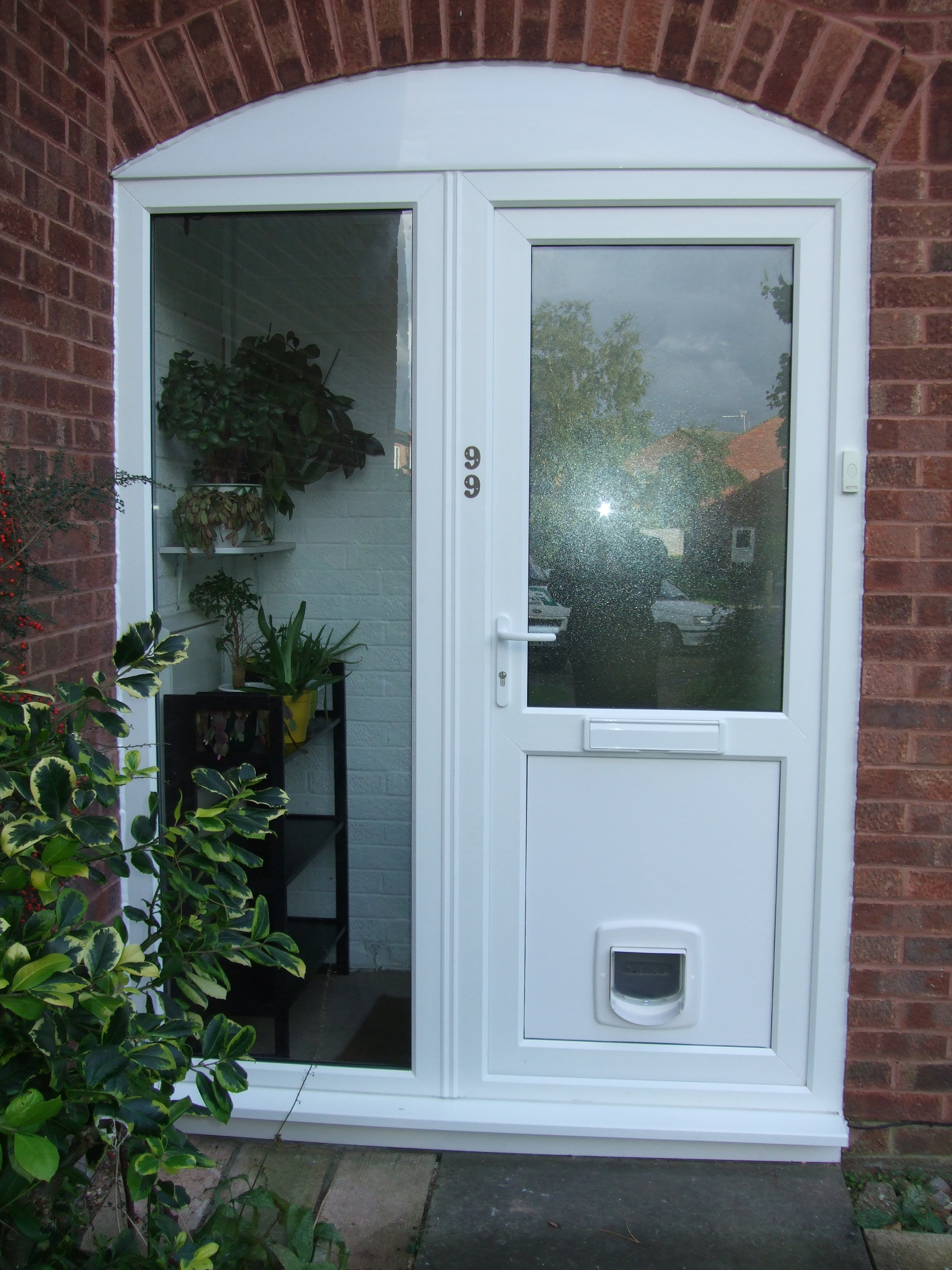 Door With Cat Flap After Double Glazing Repairs
